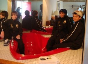 Boys in Coaches hotel room, Love the tub!